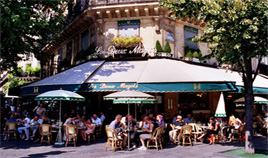 Terrace of Les Deux Magots Cafe in Paris - Summer time